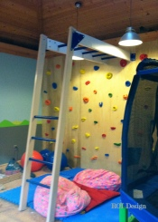 climbing wall with monkey bars in process