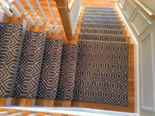 white on gray patterned carpet on stairs